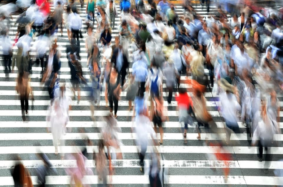 image showing a lot of people walking on zebra crossing